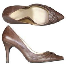 cincinnati Brown A stylish Court shoe from Jones Bootmaker. Featuring this seasons key feature, a set back heel along with sweeping leather and knot to the toe and a padded leather in sock. http://www.comparestoreprices.co.uk/womens-shoes/cincinnati-brown.asp