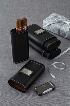 This masculine cedar-lined cigar case holds three cigars and your message to him. Pebble-grain texture adds extra style. https://www.thingsremembered.com/pebble-grain-cedar-lined-cigar-holder/product/770042?fcref=pinterest
