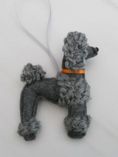 This handsome fella is a gray felt poodle ornament. (In real life, he might be considered a silver or a blue.) He is made from craft felt and