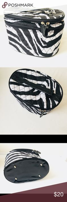 Zebra 2-Tier Cosmetic Case/Travel Case Zebra Patterned Cosmetic Case/ Travel Case with a faux Patented Leather Handle and Bottom. 2-Tier Opening; Top Tier features Mirror 3 Elastic Loop Holders, Bottom Tier Features, 6 Elastic Loop Holders, and Removable Snap Pouch. 10Lx7Wx6H Bags Cosmetic Bags & Cases