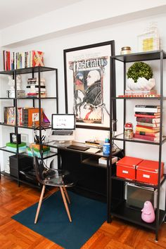 Having the top of the art extend beyond the shelves to the ceiling makes the space appear taller.
