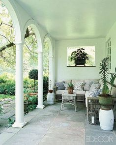 The loggia looks out onto a walled garden, and the pillows are by Dransfield & Ross.