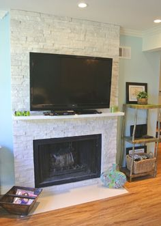 """Gorgeous white limestone fireplace with 47"""" flat screen HD TV, cable, Bluray"""