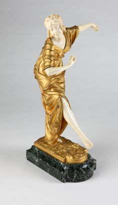 After Paul Philippe gilt bronze and ivory figure of a dancer, Circa 1925, signed 'P. Philippe' (1870 - 1930), and further ''11 E D'', depicted in a draped wrapped dress, on a verde antico marble plinth.