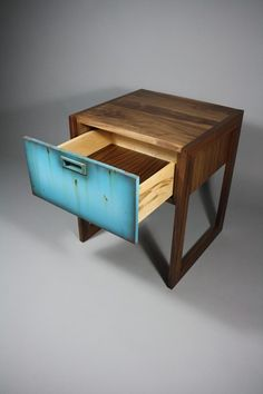 Side table by Wheeler's Studio - handcrafted using sustainable walnut. The drawer face is made from mdf and hand painted with oils and acrylics to resemble a weathering effect.