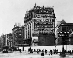In 1901, the crossroads of 23rd Street, Fifth Avenue, and Broadway had not yet taken final form.  The Flatiron Building was just beginning construction--which you can see from the big white fence wrapped around the site.  The grand Heinz 57 ad on the side of the Cumberland Hotel was the first electric sign in the U.S., illuminated by 1,200 bulbs that used $90 of electricity a year.  Within a year, both the sign and the Cumberland would be demolished.