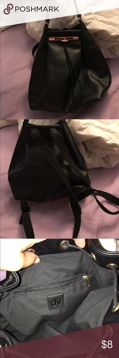 Black backpack style purse Used once.  Clean and no defects seen.  You can wear as backpack or as a shoulder bag Bags Backpacks