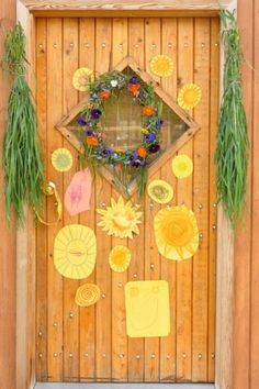 Decorate your front door with images of the sun in tones of orange and yellow.  This simple wreath is lovey but my favourite is the hanging grasses!  http://rhythmofthehome.com/2013/06/celebrating-together-summer-solstice-traditions/