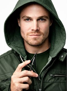 Stephen Amell, what do I like about a guy, in a green hood, with arrows, must be everything :)