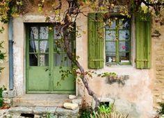 cottage with green shutters & door