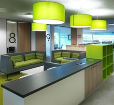 Lime green office design >> Newcastle design and build >> Bring a striking colour like lime green into your office design project to transform your space. We used neutral fittings like wood doors, white walls, and grey worktops and accessorised with lime green drum lampshades, green cushions, and a green storage unit. In doing so we have created an invigorating workspace that can be easily updated when needed. See more of this fit out project by clicking the image...