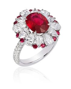"18K white gold ""Bridget"" ring featuring a 3.08 ct. oval ruby accented with round rubies and round and pear diamonds...from Heena Chheda Shah."