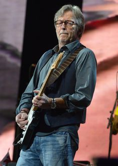 Eric Clapton Photos Photos - Eric Clapton performs on stage during the 2013 Crossroads Guitar Festival at Madison Square Garden on April 13, 2013 in New York City. - Eric Clapton's Crossroads Guitar Festival 2013 - Day 2 - Show