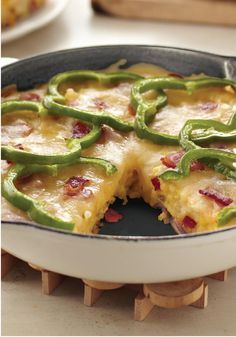 Potato & Pepper Frittata – This creamy, cheesy skillet-cooked potato frittata recipe gets a nice shot of color and flavor from green pepper rings and bits of chopped bacon!