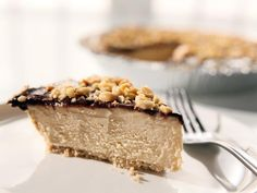 Peanut Butter Pie - Sandra Lee's rich and creamy peanut butter pie is a cinch to pull together quickly, but plan ahead before dessert; it should be refrigerated for at least an hour before serving.