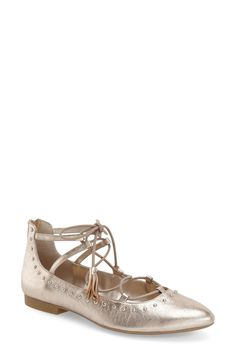 Gleaming studs accent this champagne gold trend-right lace-up flat shaped from smooth leather and styled with a gently pointed toe.