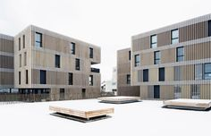 Apartment buildings by Group8asia clad in strips of travertine stone