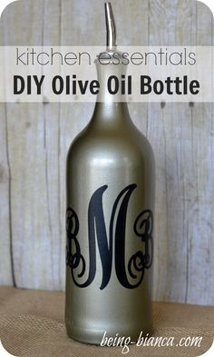Tired of staring at an ugly olive oil bottle on your counter? Check out this easy DIY to transform a wine bottle into a decorative kitchen display - DIY olive oil bottle. It's an inexpensive and easy craft project for your home!