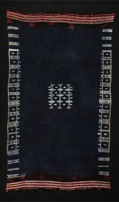 Africa | Mahmoudi (woman's mantle) from the Berber people from the border of Tunisia and Libya | Wool with cotton supplementary patterns, tie-dyed at ends. The piece is dyed after weaving and the cotton resists the indigo.: