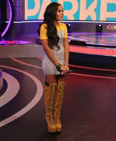 Angela Simmons Wears $400 Zigi NY's Sense Suede Thigh High Laced Boots With A $60 Monica II Dress- http://getmybuzzup.com/wp-content/uploads/2013/09/192999-thumb.png- http://getmybuzzup.com/angela-simmons-wears-400-zigi-nys-sense-suede-thigh-high-laced-boots-with-a-60-monica-ii-dress/-  By Don Bleek Media personality and entrepreneuress Angela Simmons once again was spotted styling while handling hosting duties on BET's 106 & Park. She showed off her great fashion