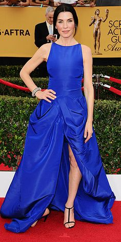 The Night's Biggest Risk Takers | JULIANNA MARGULIES | We're always on board with a head-turning hue like this cobalt blue on the red carpet, but it was another element of this Giambattista Valli  gown that caught our attention: the highly structural, almost curtain-like skirt on her dress.