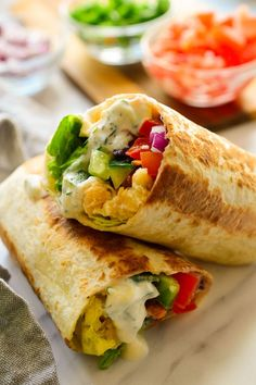 These vegan Mediterranean wraps feature smashed chickpeas, colourful veggies and a tangy herby tzatziki sauce. These fast and easy vegan wraps can be made ahead for a packed lunch or quick snack when you're on the go. Veggie Recipes, Whole Food Recipes, Vegetarian Recipes, Cooking Recipes, Healthy Recipes, Vegetarian Wraps, Vegetarian Sandwiches, Healthy Food, Veggie Food