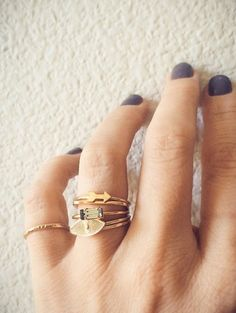 Mixing it up, delicate gold rings en masse, @bingbangnyc.