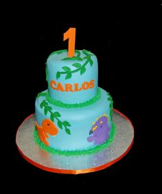 2 tier baby dinosaur 1st birthday cake trex and triceratops by Simply Sweets, via Flickr