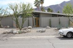 Let's face it. A midcentury home looks even better with a beauty like this parked on the sidewalk.