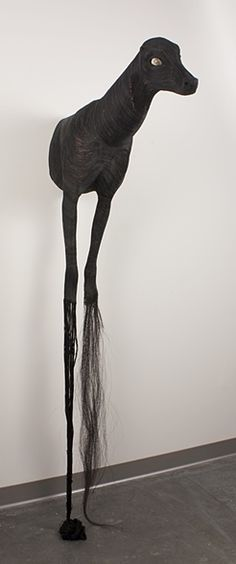 The Mask by Lindsay Pichaske. Low-fire ceramic, metal armature, string, horse hair, sheep eyes, resin