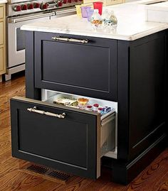 Updates That Pay Back Refrigerator drawers are tucked into this island from Plain & Fancy Custom Cabinetry.Refrigerator drawers are tucked into this island from Plain & Fancy Custom Cabinetry. Kitchen Island Storage, Kitchen Pantry, New Kitchen, Kitchen Dining, Kitchen Decor, Kitchen Appliances, Kitchen Soffit, Kitchen Ideas, 1950s Kitchen
