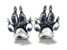 Dog Paw Cufflinks. The dog paw is roughly 1 inch tall by 3/4 inch wide. Comes in a stylish black cuff link gift box. All orders come with FREE shipping within the US.