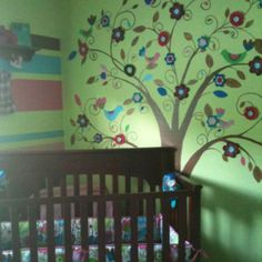 Our baby girls room-felt flowers attached to the hand painted tree. So calming in the morning light.