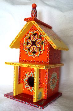 Whimsical Wooden Birdhouse with bright orange, red and yellows.