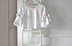 white bow sleeve crop top.