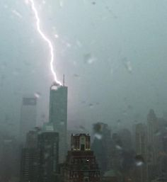 NYC. Bloomberg building hit by lightning, Hurricane Sandy.