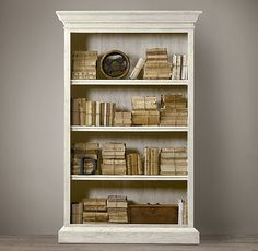 French Casement Bookcase:   My most affordable version would involve buying an affordable one in Ikea on at a garage sale, add crown molding which I can purchase in Home Depot and work on the weathered-look finish.