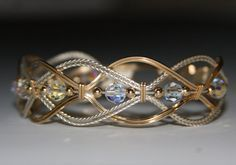 Wire wrapped Braided Bangle Bracelet by JanCramer on Etsy #wirewrappedringsstones