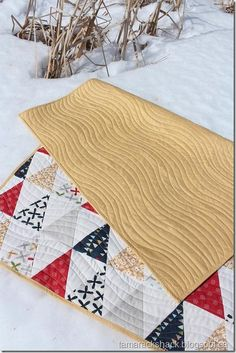 Love the colors and triangles in this quilt.