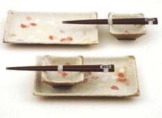 "Sakura Cherry Sushi for Two Sets F965D by Jersey Garden. $32.95. Sakura Cherry pattern; Made in Japan; Sushi plate and sauce bowls. Made in Japan, 2 pcs. 8 1/2"" x 5"" rectangular plates, 2 pcs. sauce bowls & 2 pairs chopsticks"