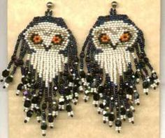 Large beaded fringed snow owl earrings.