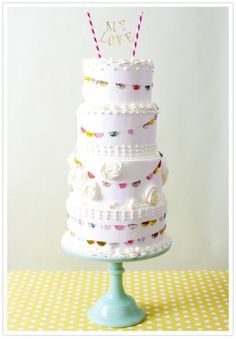 tiered banner cake. More party inspiration at www.getthepartystarted.etsy.com