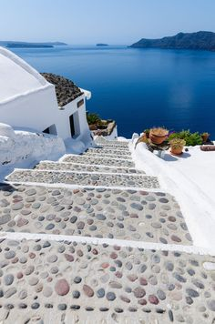Walking around town I took this beautiful rock stairs that feel like they are leading directly to the sea. From Oia with love