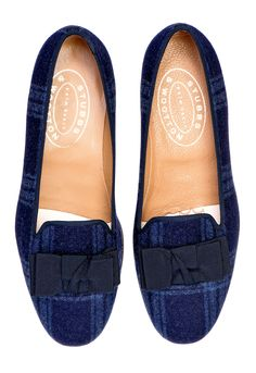 """The Navy Bow Skimmer features a rich, plaid flannel upper and a deep navy grosgrain ribbon trim and bow. Meticulously hand-crafted in Spain. Leather lined to provide additional support and comfort. The stacked wooden heel is ¾"""" in height. Leather soled. True to American sizing. *Bow Skimmer Navy isn't available yet; sign up for our newsletter to be the first to know!"""