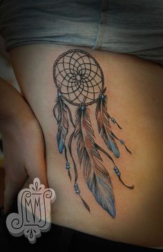 I want a dreamcatcher tattoo , but not as big and on my side/hip....love the touch of color