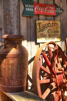 Vintage country milk Can and wagon wheel