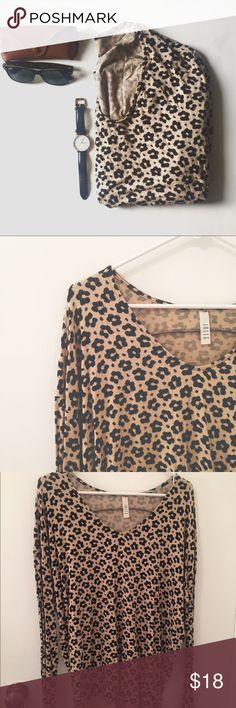 Jolie Leopard Sweater Make a statement with this Leopard Print Sweater. Delicately made with a soft rayon blend, this will be your go-to piece and have you looking fabulous and bright, even on a gloomy day. Sweater is light weight and tan/black. Worn only twice so in excellent condition.  96% Rayon, 4% Spandex Made in the USA Jolie Sweaters V-Necks