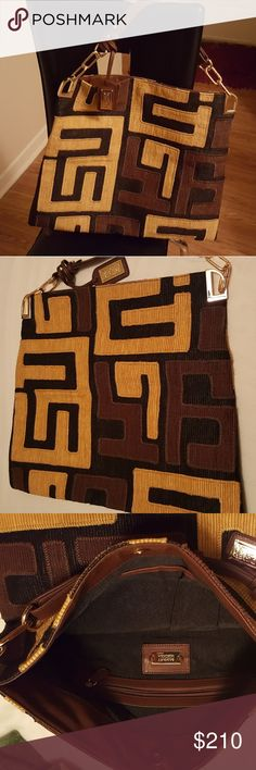 Badgley Mischka  Multi color tote. Yellow/Orange, brown and black tote.This  tote is clean in and out .Fabulous  and cute. Bags Totes