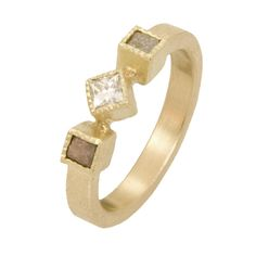 Three stone ring with a twist.  Available by special order. (TRDR282-PD)