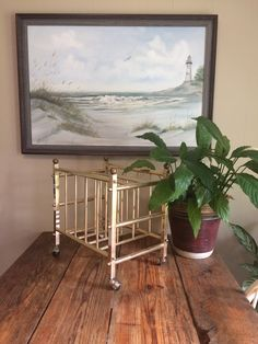 Vintage Mid Century Rolling Brass Magazine Rack by VintageFunkHouser on Etsy